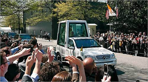 US Treasury Department employees waved to the popemobile with Benedict on board.