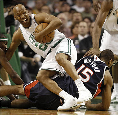 Sam Cassell fell over Al Horford during the first half.