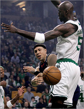 Hawks guard Mike Bibby dumped the ball as he was pressured by Kevin Garnett during the first half.