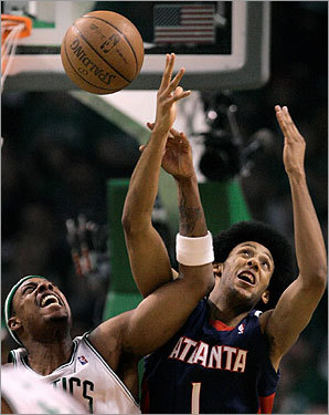 Paul Pierce fought for a rebound with Hawks guard Josh Childress during the first half.