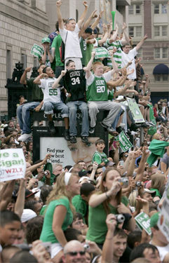 Celtics fans represented their favorite players and cheered the team from the roof of a bus stop as members of the Celtics passed by during the parade. Spectators down below sat on one another's shoulders and strained to see over the crowds.