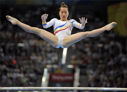 Romania's gymnast Steliana Nistor did a release off the uneven bars.