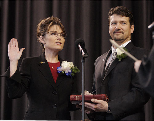 The Surprise Republican Sarah Palin, 44, was Alaska's first female governor and the first born after it became America's 49th state. In this Dec. 4, 2006, file photo, Todd Palin (right) held the Bible for his wife when she was sworn in as Alaska's governor.