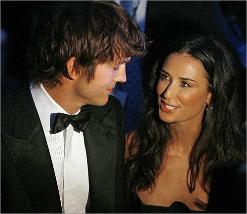 The actors Ashton Kutcher and his wife, Demi Moore, attended the Presidential Inaugural Youth Ball, one of 10 the Obamas were to attend.