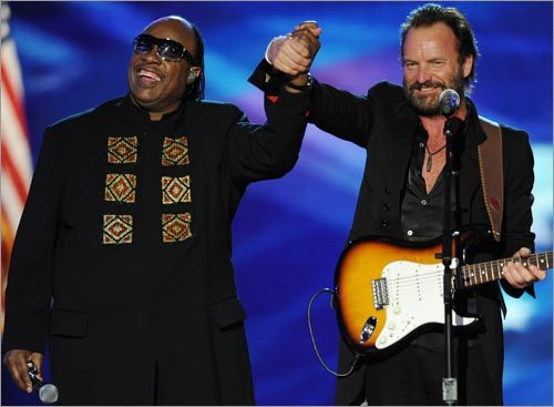 Stevie Wonder, left, and Sting performed together at the Neighborhood Inaugural Ball.