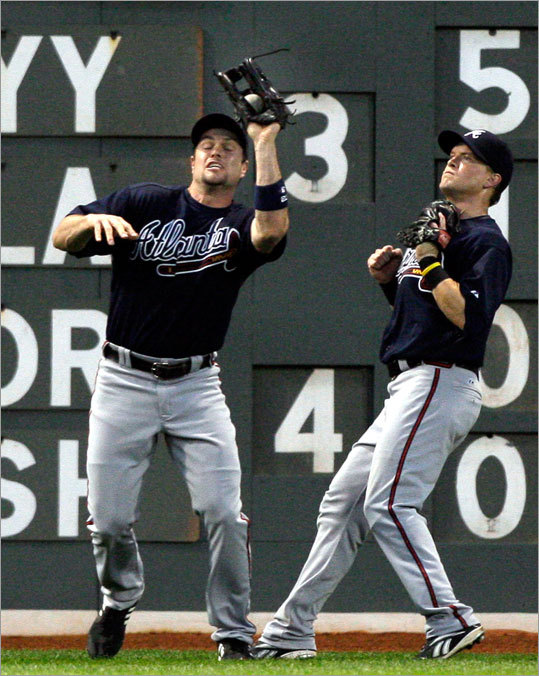 Braves leftfielder Matt Diaz made the catch on a fly ball hit by David Ortiz during the fourth inning. Centerfielder Nate McLouth watched.