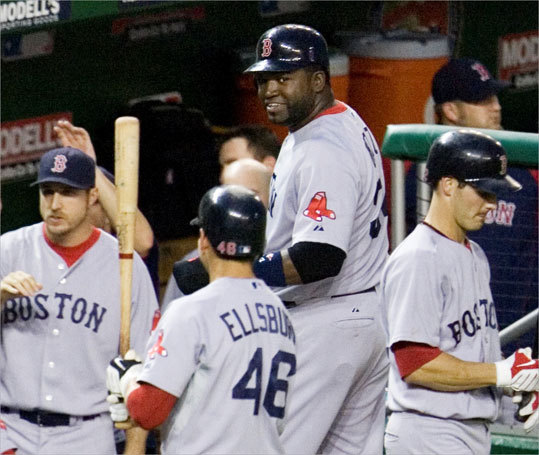 David Ortiz (center) looks toward Jacoby Ellsbury after Ortiz scored on Jason Varitek's home run during the sixth inning. The Sox beat the Nationals, 6-4.