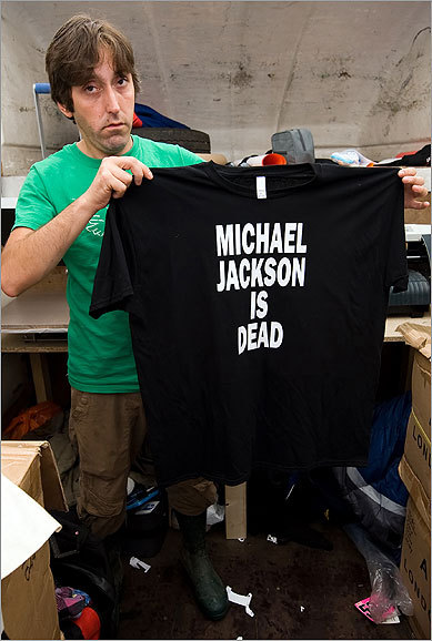 Pop legend Michael Jackson died yesterday at the UCLA Medical Center in Los Angeles. Admirers the world over expressed shock and sadness upon learning the 'king of pop' was dead. Jackson was 50 years old. A stall holder stood with his freshly printed 'Michael Jackson is dead' shirts at the annual Glastonbury Festival, which nearly 140,000 people are expected to attend, in England on June 26, 2009.