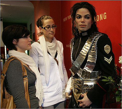 Birgit Stettner (left) and Julia Schaeffler, both from the German city of Stuttgart, viewed a waxwork figure of Jackson at Madame Tussaud's waxworks museum in Berlin on June 26.
