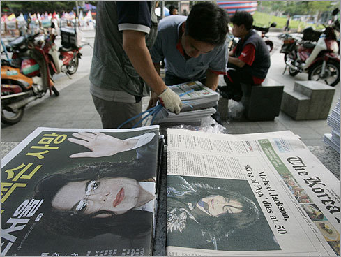 Newspapers at a distribution center in Seoul, South Korea, on June 26 reported Jackson's death. The headline at right read 'Michael Jackson, 'King of Pop,' dies at 50.'