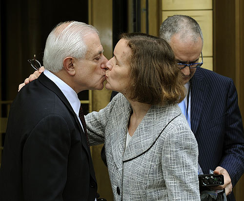 Victim Bert Ross gets a kiss as he leaves United States Courthouse in New York, June 29, 2009, after Bernard Madoff received 150 years in prison for his multibillion-dollar fraud scheme.