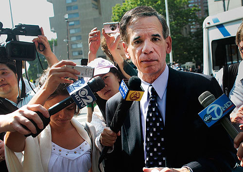 Ponzi scheme victim Richard Friedman of Jericho, N.Y., talked to reporters in front of the Manhattan courthouse.