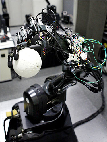 A pair of baseball-playing robots that can pitch and hit with incredible results have been developed by University of Tokyo professor Masatoshi Ishikawa, according to the Associated Press . Here, a pitching robot grips a ball made of polystyrene during a lab demonstration. The robots don't resemble humans but instead the type of robots on a car assembly line.