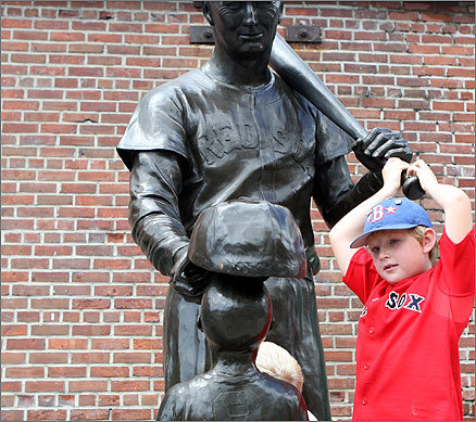 "Ian Cox, 9, played on the Ted Williams statue outside Fenway yesterday. He is barely old enough to remember Ortiz's first prolific season with Boston, and says Ortiz ""should have known better in the first place.'"