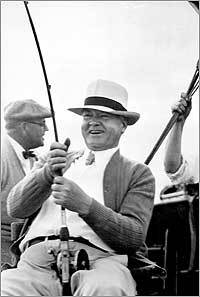 President Herbert C. Hoover laughed as he hooked one of the five large sailfish he caught on his vacation trip aboard the Sequoia in Florida waters in January 1933. The photograph was taken by the president's secretary, Lawrence Richey.