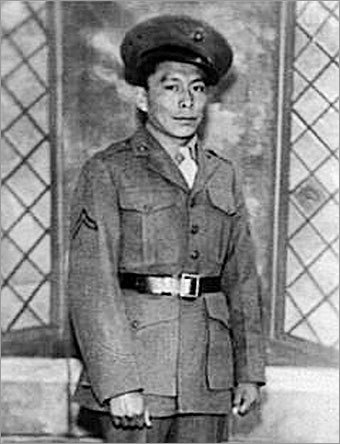 Samuel Tom Holiday of Kayenta, Ariz., is shown while serving in the US Marine Corps as a World War II Navajo Code Talker. Holiday, now 85, was scheduled to be at today's Veterans Day Parade in New York. Until the Navajo code was created, the Japanese were able to intercept and sabotage US military communications at an alarming rate.