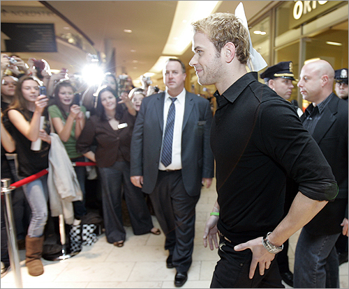 The young actor arrived and eager fans waited yards away with their anticipation having turned to excitement and a red velvet rope separated Lutz from the fans.