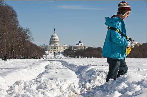A boy walked through snow on the National Mall in Washington, D.C.