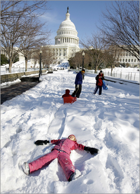 Clare Anna House, 5, made a snow angel on the West Front of the US Capitol in Washington.