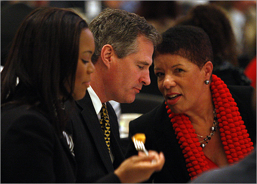 Brown joined Yolanda Darnell, left, and Jane Edmonds at the MLK breakfast.