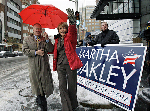 Martha Coakley, accompanied by her husband, Tom O'Connor, waved to supporters as she arrived at a breakfast honoring the life of the Rev. Dr. Martin Luther King Jr. in Boston.