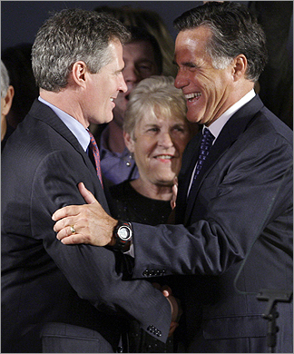 Brown celebrated with former Massachusetts governor Mitt Romney.