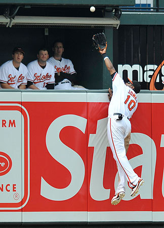 Adam Jones couldn't come up with J.D. Drew's home run in the seventh despite his valiant try.