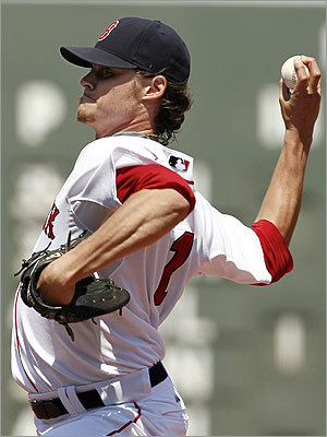 Red Sox starting pitcher Clay Buchholz delivers against the Detroit Tigers first-inning action. Buchholz pitched well, allowing just two runs over eight innings, but he did not factor in the decision.