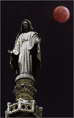A view of a statue atop St. Patrick's Cathedral in New York during the lunar eclipse.