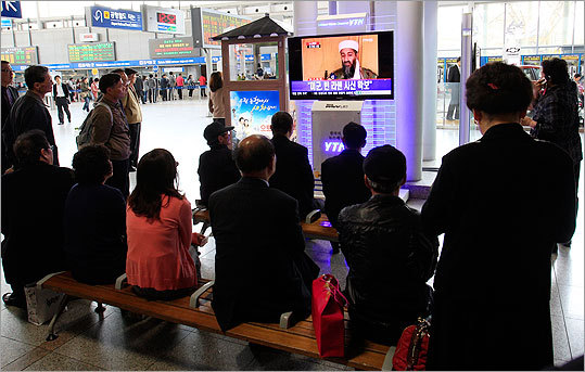 South Koreans watched a TV broadcasting a report about the death of Osama bin Laden at a train station in Seoul, South Korea.