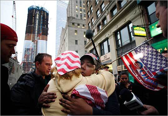 Dionne Layne, facing camera, hugged Mary Power as they reacted in New York to the news of the death of Osama bin Laden. At left is a rising tower, 1 World Trade Center, also known as the Freedom Tower.