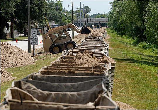 Baskets were filled with sand to protect neighborhoods from flooding ahead of the likely diversion of the Mississippi River.