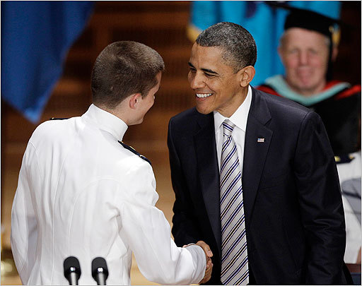 Prior to his Boston stop, Obama gave the commencement speech at the US Coast Guard Academy in New London, Conn. At left, Obama shook the hand of cadet first class Nathan Crum.