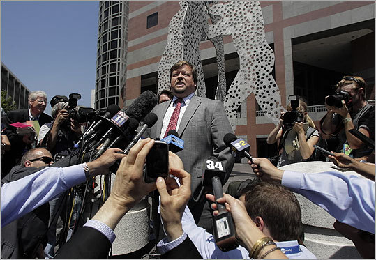 Assistant US Attorney Robert Dugdale (center) spoke to reporters outside the Roybal Federal Building in Los Angeles after Bulger's arraignment.