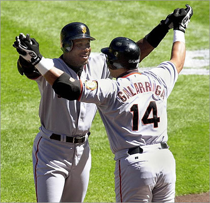 Bonds advanced toward McGwire Bonds hit three home runs on Sept. 9, 2001, giving him 63 for the season to pass Roger Maris's mark of 61 and move him closer to Mark McGwire's record of 70. Bonds's third homer was a three-run shot in the 11th inning that helped lift the San Francisco Giants over the Colorado Rockies. Bonds (left) was congratulated by teammate Andres Galarraga (right) after Bonds's 61st home run of the season at Coors Field in Denver. Story: Bonds takes three steps toward Mark