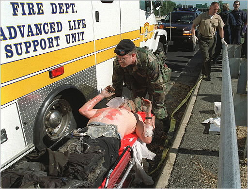 Following the attack on the Pentagon, an injured victim was loaded into an ambulance. A total of 125 people in the Pentagon were killed.