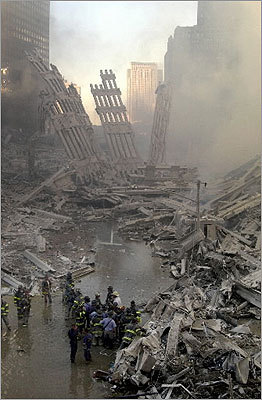 Emergency personnel gathered at the site of the fallen World Trade Center.