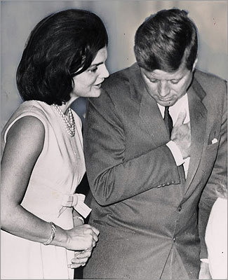 'The tapes have the effect of humanizing Mrs. Kennedy and providing hints of the person she was in the spring of 1964,' Fitzpatrick said. 'She was then a young woman, who was only a few months away from a profoundly traumatic experience. Yet she speaks with intelligence, wit, composure, a good deal of penetrating observation, humor, some anger, and certainly very strong opinions about her White House years.' Pictured: President Kennedy listened closely to his wife as they stood in public while Franklin D. Roosevelt, Jr. was sworn in as undersecretary of commerce on March 2, 1963.