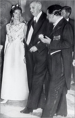 '[Caroline has] shown she can handle it - she trusts enthusiasts and critics of her family can handle it, too.' Pictured: France's former President Charles DeGaulle, center, and former Minister for Cultural Affairs Andre Malraux, escorted Mrs. Kennedy to the Louis XV theater in the Chateau of Versailles on June 1, 1961.