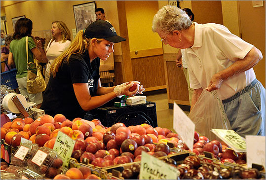 Left: Employees will chop fresh fruit and vegetables in the produce aisles so customers can take home customized stir fries, kebabs, and salads at Wegmans. Elizabeth Ognenovski, left, helped Jean Ferris shop for peaches at the store in Pittsford.