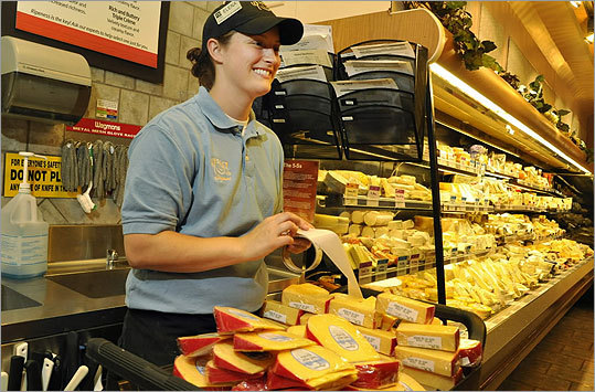 The 138,000-square-foot store in Northborough features some trademarks from Pittsford: a cheese shop, Mediterranean bar, make-your-own trail mix bar, and chef-prepared meals. Left: Elena Lefkus at the Pittsford store's cheese department.