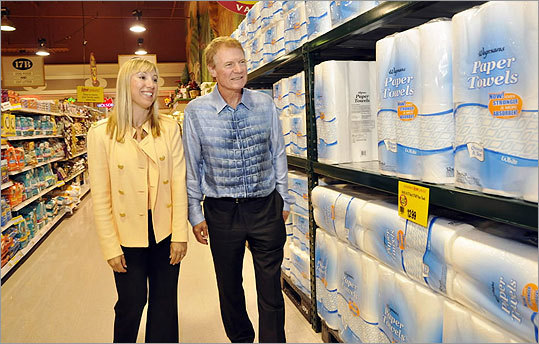 The supermarket company has won a pile of customer service and best workplace honors. Left: Danny Wegman, and his daughter, Colleen, walked down an aisle in the Pittsford store. Colleen Wegman is company president.