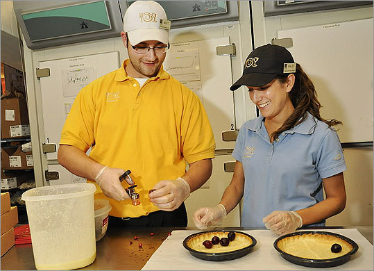 Wegmans has made Fortune's list of 100 Best Companies to work for every year since 1998. Matt Titus (left) and Haley Ward, who will work in Northborough, participated in bakery management training.
