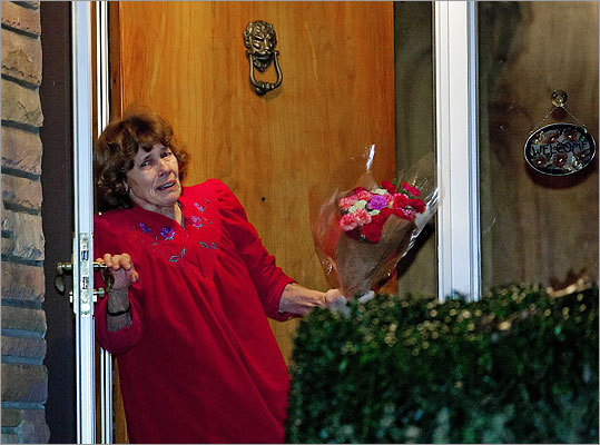 Sue Paterno picked up a bouquet of flowers left on the front porch of her home.