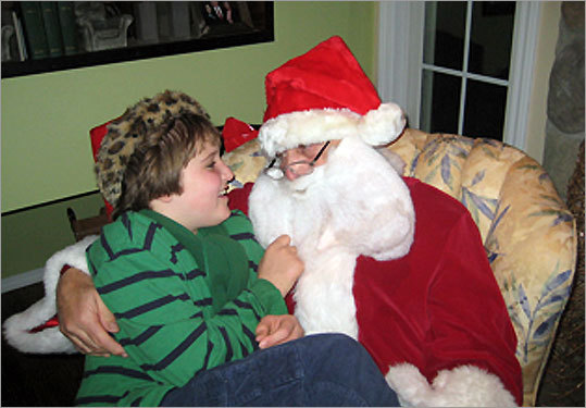 Ben Borre, 10, of West Hartford, Conn., with an autism-friendly Santa Claus.