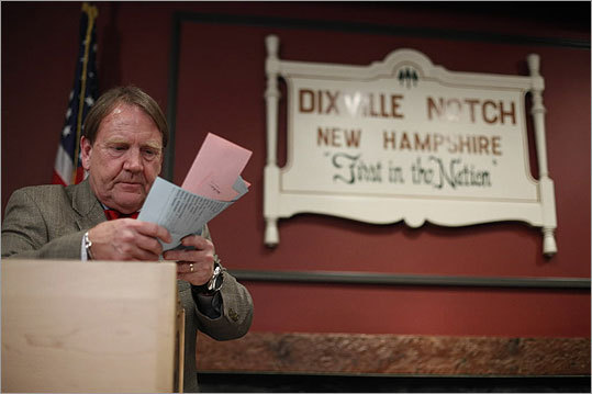 Tom Tillotson, the small town's moderator, removed ballots for counting after midnight.