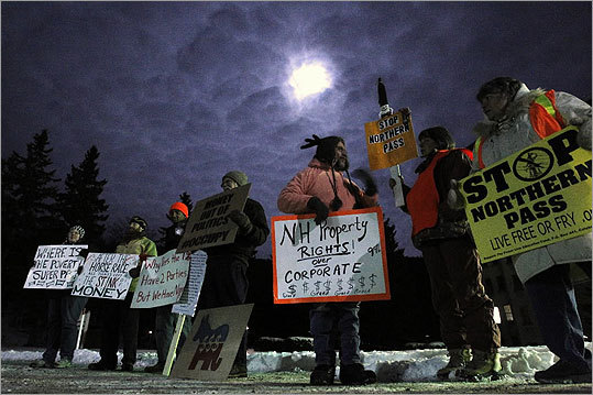 Protesters, including members of the Occupy movement, gathered outside the sight of the the Balsams Grand Resort on Monday night.