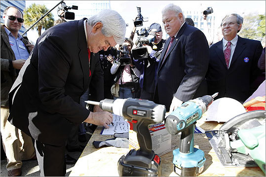 Newt Gingrich signed a pledge in support of a home owner mortgage tax deduction on Jan. 12 during a rally for home ownership at the State Capitol in Columbia, S.C.