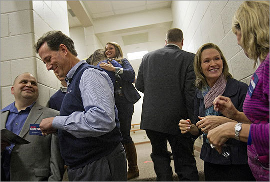 Rick Santorum and his wife, Karen, second from right, talked with supporters before he took the stage for a campaign town hall meeting in Charleston, S.C., on Jan. 12.