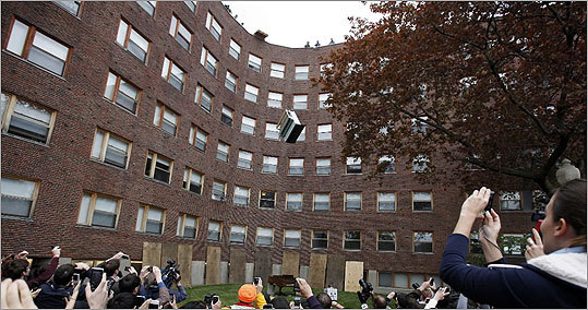 A crowd watched as a piano fell from the roof of Baker House dormitory at MIT in Cambridge. The event began in 1972 and is staged to celebrate the last day students can drop classes without having them appear on their college transcript.